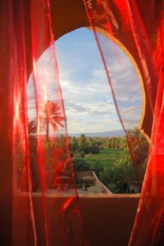 ~the warm breeze blows against the sheer curtains that adorn the decorative window causing the material to dance like a sensuous belly dancer...