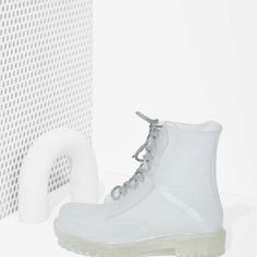 Roadie Combat Rain Boots April showers bring May flowers! Be prepared this rainy season with a different kind of rain boot! Now there's a new way to stay CLEAR... from the rain! Gently worn, soles are darker in color due to streetwear, but nothing a good washing can't fix. The Roadie Rain Boot has a plastic translucent PVC exterior, gray rope laces, rounded toe, and treaded sole. Dirty Laundry Shoes Winter & Rain Boots