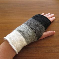 This warm and cozy fingerless gloves knitting pattern is both trendy and functional. The Knit Ombre Handwarmers are darling cold weather accessories featuring gradating shades of white, gray, and black in a clean and simple block design.
