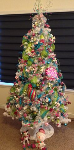 Christmas Tree Themes - White tree with bright colors
