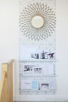I love this stenciled wall!  It's a great way to bring interest to a blank wall and a way to group wall decor -- Sarah M. Dorsey Designs