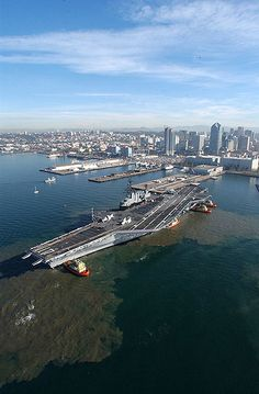 The decommissioned aircraft carrier Midway prepares to moor at its final resting place at Navy pier where it will become the largest museum devoted to carriers and naval aviation. When commissioned on September 10, 1945 as USS Midway (CVB 41) she was the largest carrier ever put to sea. The USS Midway Museum, San Diego, California. U.S. Navy photograph by Photographer's Mate 1st Class Arlo K. Abrahamson.