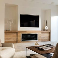 wood tone mixed with fireplace and inset tv
