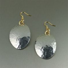 Transform a classic design into a statement piece with these Hammered Aluminum Oval #Earrings. Hand #hammered #Aluminum is accented by 14K Gold-filled French Earwires. $48
