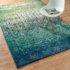 Rug for living room? Bring a touch of the tropics to your living room with this Skye Monet blue cascade rug from Alexander Home. The varying blue and green colors evoke the feeling of motion in a still room, and the abstr Living Room Green, Rugs In Living Room, Eclectic Decor, Coastal Decor, Coastal Rugs, Modern Coastal, Coastal Bedding, Coastal Furniture, Coastal Farmhouse