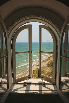 Arch window view to water.