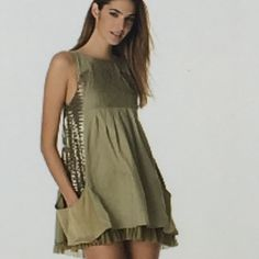 "HPx2 Alice + Olivia Safari Sequin Panel Dress Stunning Alice + Olivia smocked top tank Safari dress with wide sequin panels on both sides going down into pockets. Sequins show front & back. Built in slip underneath with tulle trim that shows on bottom of dress. Color is a soft olive green. Never worn & has tags. Purchased from Nordstrom. This dress runs small, it will not fit on mannequin. True 0 measures 33"" from shoulder to hem & 17"" across bust. Alice + Olivia Dresses Midi"