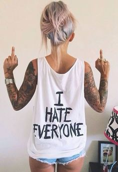 Not sure if I like her tats, hair or shirt more lol