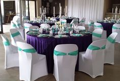Purple tablecloths, white chaircovers, teal bands & teal napkins, candle holders on mirrors Wedding Decorations, Wedding Ideas, Table Decorations, Party Hire, Tablecloths, Mirrors, Napkins, Candle Holders, Porta Velas
