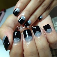Black nails with glitter half moon