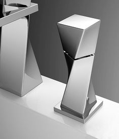 Unique minimalist product design Turn - from sculpture to tap by Joerger