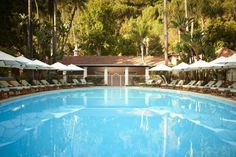 Hotel Bel-Air (701 Stone Canyon Road) This historic, 1950's hotel is located in Bel-Air neighbor of Los Angeles and features rooms with flat-screen TVs. The hotel has a large garden and the La Prairie Spa is a full-service spa located on-site. #bestworldhotels #travel #us #losangeles
