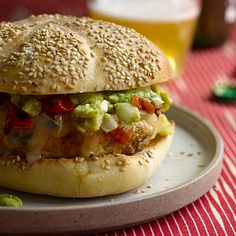 Chicken Burgers with Guacamole, Cheddar, and Charred Tomatoes - a healthy burger recipe made with ground chicken, fresh cilantro, and breadcrumbs, then topped with homemade guacamole, roasted tomatoes, and melted cheddar.