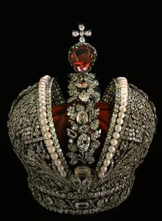 Created in 1762 for the Empress Catherine II, this crown formed part of the state insignia of czarist Russia. The crown was made by a team of goldsmiths headed by the jeweler Jeremie Pauzie and took two months to make. The style of this crown is Byzantine and the two halves represent unity between the eastern and western Roman Empire. It has 75 pearls and a large spinel gemstone below its cross as well as over 4,000 diamonds. There is a 55 carat diamond at its base.