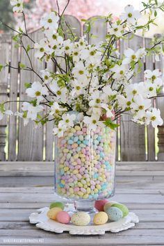 Easy Easter table centerpiece of jelly beans, dogwood and plum tree blossoms | homeiswheretheboatis.net