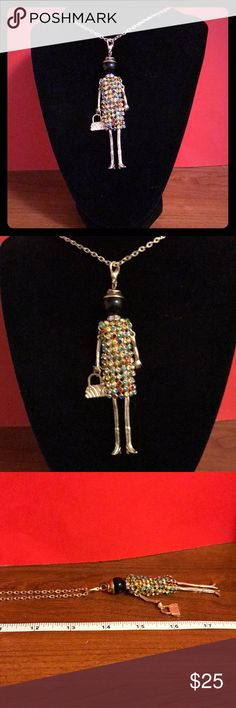 DOLL NECKLACE multiple colors Multi unique doll necklace with gold chain, Chain is 13 inches long. Her face is black, gold arms and legs and also a little unique purse.multi color crystal dress.Brand new. Lucy & Ethel Jewelry Necklaces