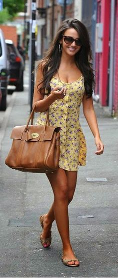 Beautiful yellow floral printed summer mini dress with brown leather cute hand bag and matching ladies shoes the best summer street style outfits
