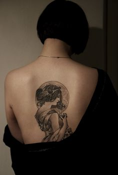 Mad cool Mucha back tattoo.