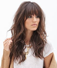 Long beach waves with thick bangs
