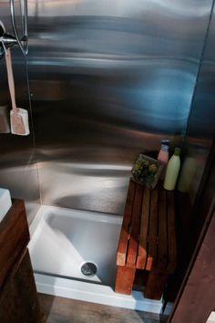 Aerodynamic Tiny Home – Tiny House Swoon I like the seat over the shower floor