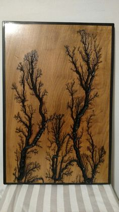 Beautiful electrically engraved wooden plaque.  Looks like several trees!