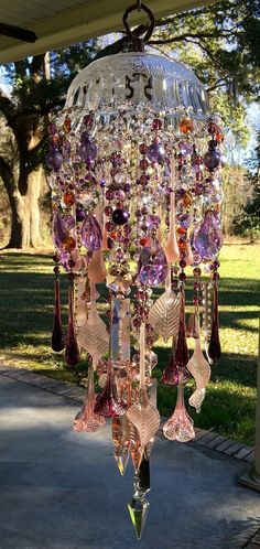 RESERVE REBA...Please do not Purchase...Secret Garden Carousel... 2nd of 2 payments A fluted raised Indonesian crystal canopy is extravagantly draped and dressed in lilacs, peachy pinks, iridescent ambers, and deep amethyst hues for a soft radiant glow to amuse and spark the imagination...such a lovely eloquence and brilliance to this windchime.  The long frosted waterdrop prisms and swirling leaves (all from Portugal) in soft pastel hues, as well as the Czech amethyst prisms are enchanting…