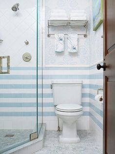 Design a walk-in shower that blends into the background. Though this shower's seamless glass enclosure is visible, it fades in importance, thanks to brightly hued wainscoting that wraps the bathroom's lower walls! http://www.bhg.com/bathroom/shower-bath/walk-in-showers-for-small-bathrooms/?socsrc=bhgpin042015discreetshower&page=12