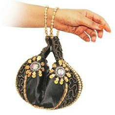 A must have accesory in black embroidery that can be used in more than one way. Use if like a traditional Potli and expand it to a regular evening clutch bag.