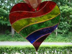 Stained glass rainbow heart LGBT equality support. $25.00, via Etsy.