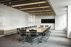 The boardroom wall folds back to reveal AV equipment.