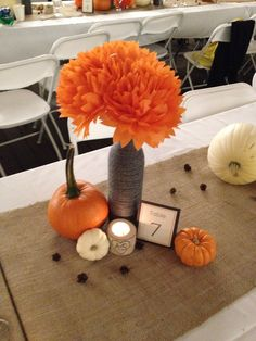 Charcoal and orange fall wedding. Wine bottles wrapped in yarn with tissue paper flowers. Orange and white pumpkins, birch candle votives and baby pinecones. Wine Bottle Centerpieces, Rustic Wedding Centerpieces, Wedding Table Centerpieces, Wedding Rustic, Centerpiece Ideas, Fall Wine Bottles, Wrapped Wine Bottles, Wedding Color Pallet, Fall Wedding Colors