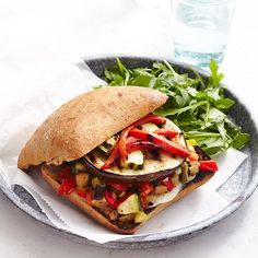 Muffaletta sandwiches, named for a Sicilian bread brought by immigrants to New Orleans, are usually loaded with cured meats, pickles and cheese. Our healthy vegetarian recipe has a trio of smoky grilled veggies. Chopped olives and banana peppers deliver the signature flavor of the classic.
