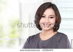 portrait of mature happy business women smiling - stock photo