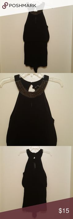 Black romper Black summer romper with gold beaded trim around the neck. Peek openings in the front and back. Very loose and flowing material great for any vacation. Charlotte Russe Other