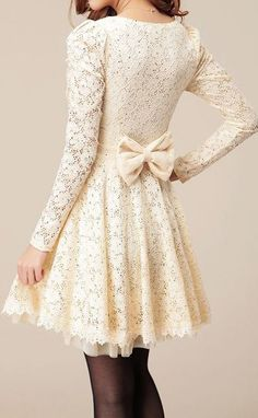 A very pretty white lace dress with a nice bow at the back for an elegant touch.