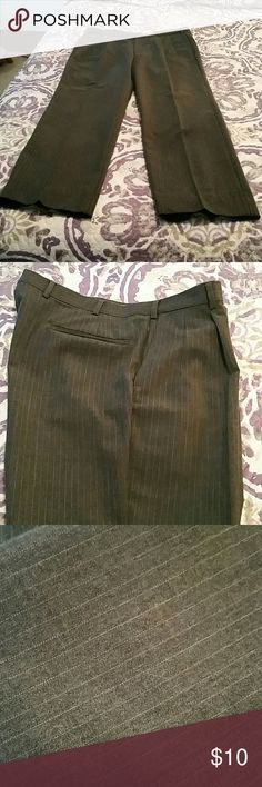 Men's dress slacks Stylish gray pinstriped slacks for the businessman. Unfortunately there are no tags on this set up slacks but they are a 36 waist 31 length. Do not know the brand. My husband's cleaning out his closet. Pants Dress