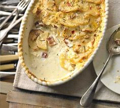 Celeriac, potato & rosemary gratin  (leave out the bacon, and sub in the vegan counterparts of milk and cream and VOILA, a comforting vegan side dish - yum!)