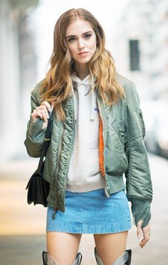 The Blonde Salad's Chiara Ferragni opted to pair her miniskirt with another trendy piece of the season: the bomber jacket and a beige hoodie