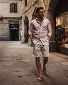 - with a casual summer outfit idea. I'm a solid pass on the footwear but the white linen shorts and pink striped button up shirt with rolled up sleeves looks good Stylish Mens Fashion, Mens Fashion Week, Mens Fashion Suits, Fashion Moda, Daily Fashion, Stylish Man, Spring Fashion, Style Fashion, Fashion Outfits