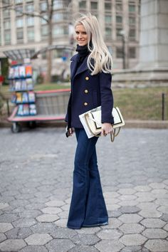 Navy pea coat, gold buttons, wide leg jean, turtleneck.