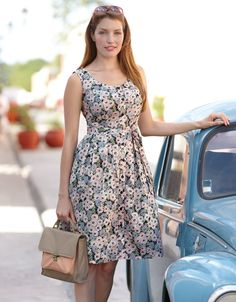 Floral Button Sun Dress from Pepperberry. LOVE that neckline, and that I could wear regular underwear with it :)