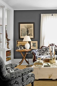 Obsidian Glass by Glidden is a dark gray that isn't gloomy. Contrasted with uplifting whites, earthy browns, and other warm hues, it's not the least bit depressing.