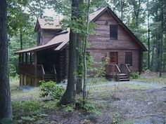 This lovely two-story log cabin is an easy one-hour drive from Baltimore and Washington, DC. Nestled deep in the Maryland woods--literally steps from ...