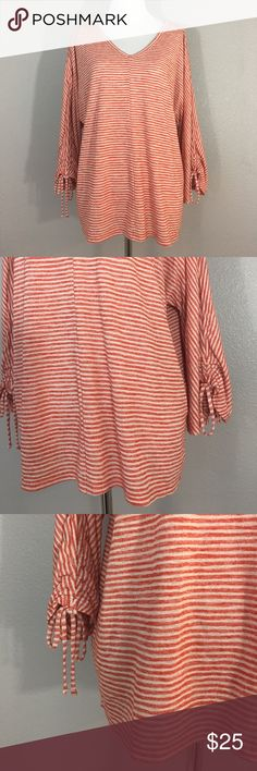 """Women's Chico's gathered sleeve v neck sweater 2 L Women's Chico's gathered Sleeve v neck sweater. Orange and white striped. Size 2 which is a large. 55% Modal 45% Polyester. Measurements laying flat- armpit to armpit: 23"""" nape to hem: 23"""" Chico's Tops Sweatshirts & Hoodies"""