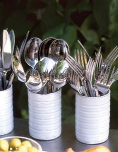 reusing tin can as cutlery holders.
