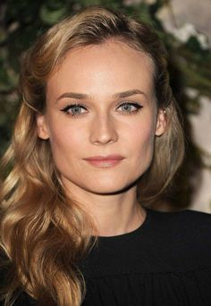 Diane Kruger: Soft pink lip and cheek, peachy beige shimmer on the lids, retro black liquid liner, and satin finish foundation.