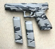 'Urban Camo' cerakote on this full sized Glock and magazines.