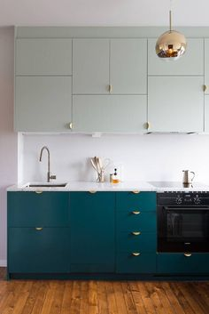 blue lower kitchen cabinets and mint upper cabinets. / sfgirlbybay