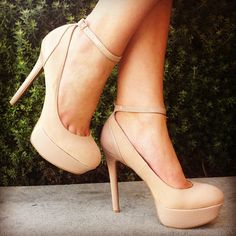 Nude platform pumps with ankle straps. A closet staple