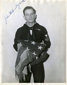 U.S. Navy Corpsman, John Bradley, was one of the three surviving men who raised the American Flag over Mt. Suribachi during the Battle of Iwo Jima in WWII